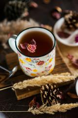 Tuinposter Cafe Flower tea: tea rose, petals, edible flowers, on a light background