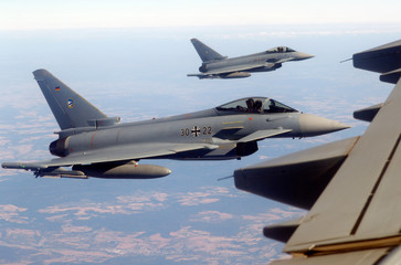 German Eurofighters demonstrate a flight interception of a Belgian air force transport plane over Germany