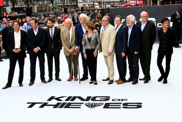 Actors Sir Michael Caine, Ray Winstone, Francesca Annis, Charlie Cox Paul Whitehouse, Sir Michael Gambon, Sir Tom Courtenay and Jim Broadbent, screenwriter Joe Penhall and singer Jamie Cullum arrive at the world premiere of King of Thieves in London