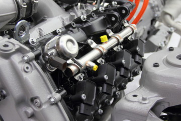 Model of modern new car V12 gasoline engine - motor block, fuel ramp and ignition coils
