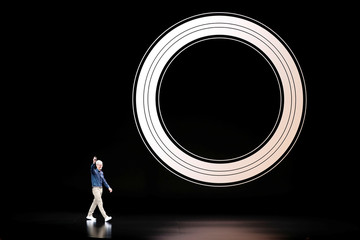 Tim Cook, CEO of Apple, arrives on stage for an Apple Inc product launch in Cupertino