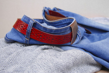 Jeans blue denim fabric clothing textiles and a red leather belt