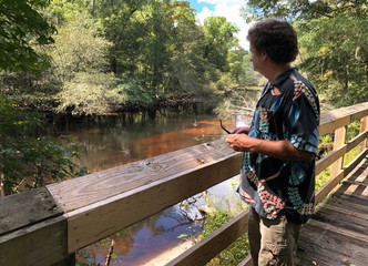 Town manager Al Leonard surveys the Fair Bluff River Walk overlooking the Lumber River in Fair Bluff, North Carolina