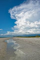 Cumulus cloud reflection in tidal pool