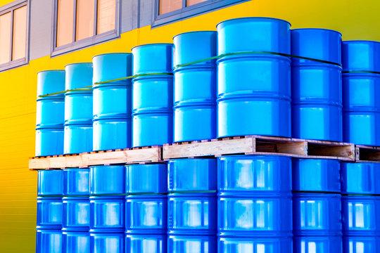 Warehouse of metal barrels. Chemistry. Chemicals in barrels. The metal barrels are blue. Chemical industry. Barrels on flights.