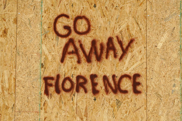 A message is posted on a boarded up building before the arrival of Hurricane Florence on Oak Island