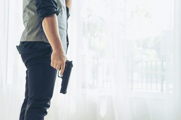 Man is stressed from work holding a gun maybe think of suicide, copy space  - business concept
