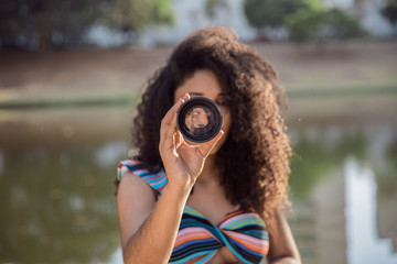 Black woman holding a camera len
