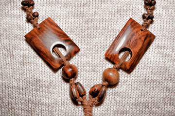 Indonesian beads made of natural wood lie on the burlap