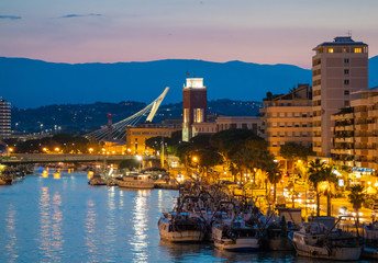 Pescara (Italy) - The view in the dusk from Ponte del Mare monumental bridge in the canal and port...