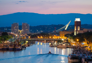 Pescara (Italy) - The view in the dusk from Ponte del Mare monumental bridge in the canal and port of Pescara city, Abruzzo region. Fototapete