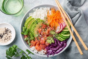 salmon poke bowl (avocado, salmon, carrot, cucumber, red cabbage, radish and rice)