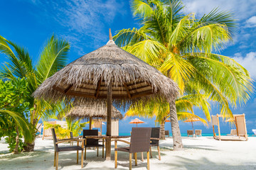 Recess Fitting Caribbean Tropical beach with chairs and umbrellas.