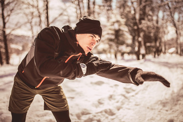 Man Sportsman Taking Break From Running in Extreme Snow Conditions