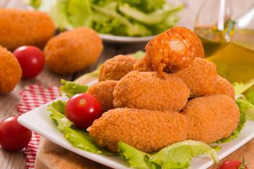Supplì, italian fried rice balls.