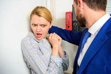 Girl victim office violence concept. Boss unacceptable behavior subordinate employee. Prevalence of sexual assault and harassment at workplace. Woman worker scared threatening violence behavior boss
