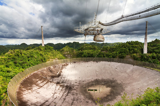 The Arecibo Observatory radio telescope in the hills of Arecibo, Puerto Rico