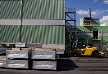 Aluminum ingots are stored outside the facility of Novelis in Sierre