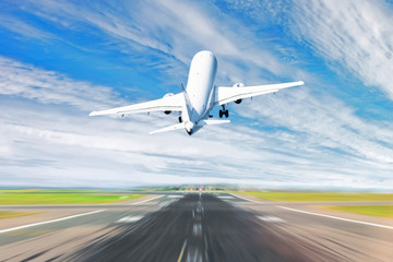 Airplane taking off from the airport - back view. Wall mural
