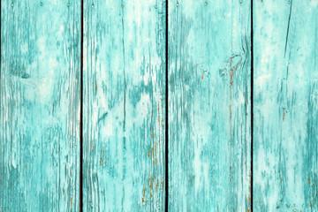 Blue color old grunge wooden fence pattern.