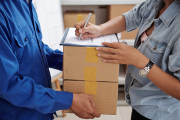 Worker man delivering the boxes to woman at home or office