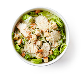 Caesar salad in take away bowl on white background; from above