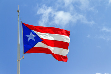Beautiful Puerto Rican flag against a blue sky