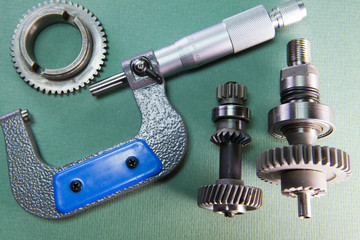 mechanical micrometer and detail on a green background..