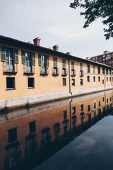 house with reflection along the Martesana canal in Milan