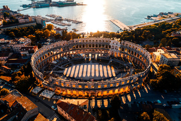Pula Arena at sunset - aerial view taken by a professional drone. The Roman Amphitheater of Pula, Istria, Croatia