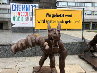 German artist Rainer Opolka's wolf sculptures gving Nazi salutes on display in Chemnitz