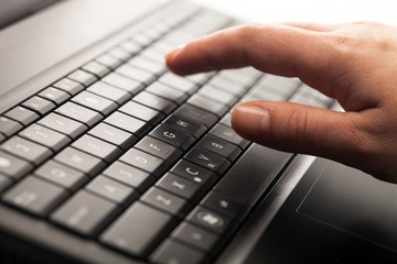 Close-Up of Hand Using Laptop