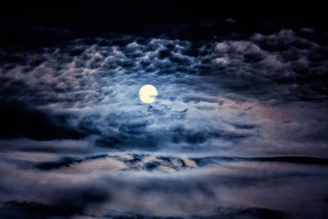 Dark night sky with moon and clouds_