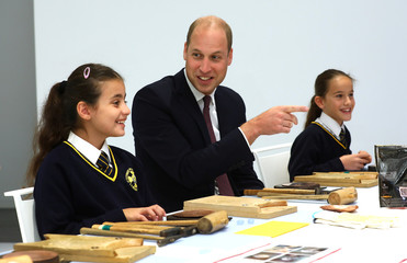 Britain's Prince William joins local school children from St Cuthbert with St Matthias CE Primary School at a copper beating workshop during the official opening of Japan House in London