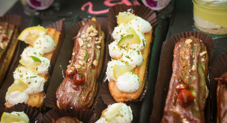 group of french dessert Eclair on black background.