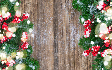 red and white christmas - twig with red berries and green evergreen tree borders on wood with copy space