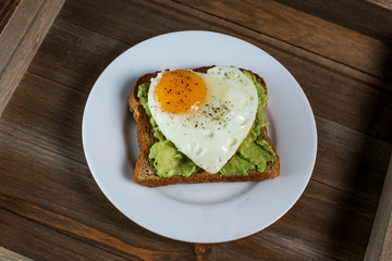 Toast with avocado and egg in heart shape