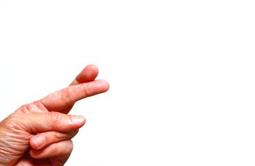 closeup image of fingers crossed