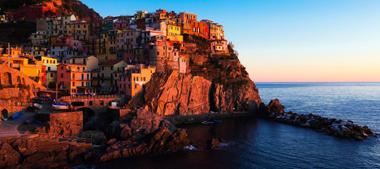 Manarola city La Spezia  at dusk on top of the hill, Italy