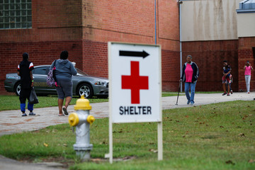 People arrive to a shelter run by Red Cross before Hurricane Florence comes ashore in Washington, North Carolina