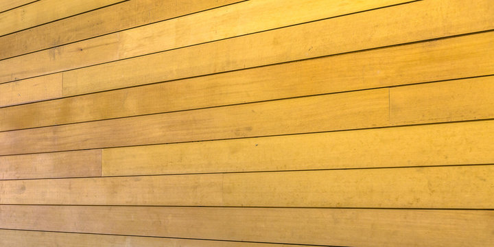 Exterior wood wall with golden brown color