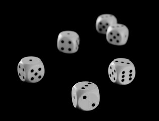 White gambling dice isolated on black background, with clipping path