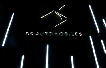 A logo is seen at PSA's DS Brand Automotive Design Network centre in Velizy