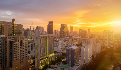Bangkok City skyline with urban skyscrapers at sunset.