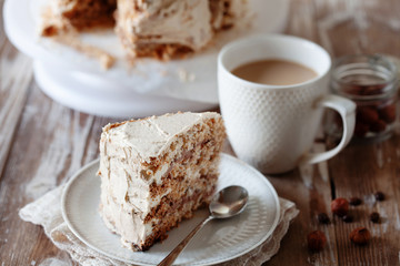 ePiece of crispy coffee and nut meringue cake with butter cream frosting