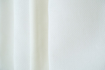 Different types of fabric for cross-stitch embroidery. White blank canvas for embroidery.