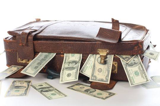 Ancient old suitcase full of banknotes