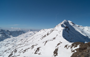Mountain peak of Alps view from top of Bormio in italy
