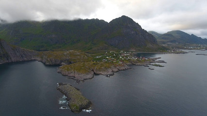 Aerial view of fishing village A in Lofoten islands at midnight sun in Norway