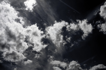 White fluffy clouds in the sky, black and white photo
